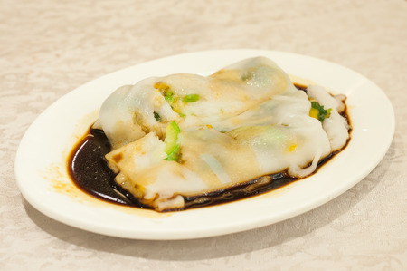 Rice noodles rolls on a plate at Hong Kong dim sum restaurant 写真素材