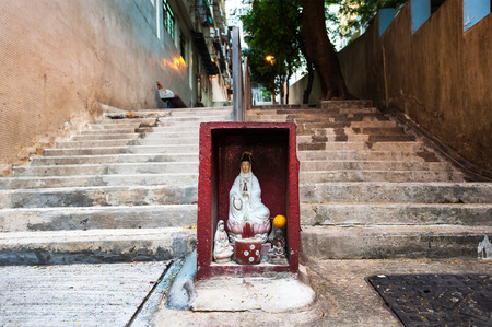 Hong Kong street shrine containing statue of Guanyin