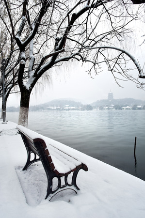 West Lake and Leifeng Pagoda in the snow, Hangzhou, China Stock Photo