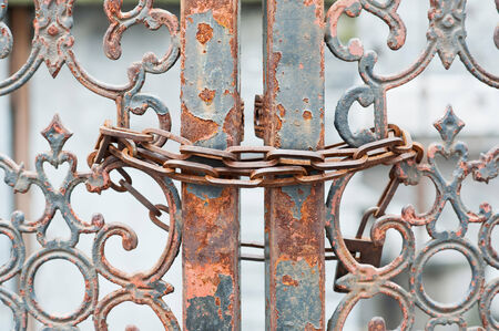 rusting: Rusting gate locked with chain  Stock Photo