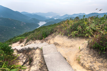 Steps leading down to Tai Tam Reservoir, Hong Kong Island Stock Photo - 34563516