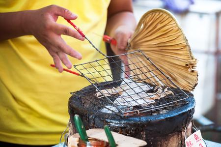 lantau: Grilled squid at Tai Fishing Village, Hong Kong Stock Photo