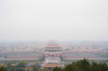 shrouded: View of the Forbidden City shrouded in pollution from Jingshan Park, Beijing Stock Photo