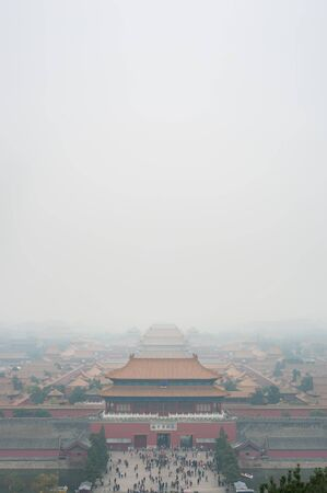 View of the Forbidden City through the air pollution, Beijing. Taken from the top of the hill in Jingshan Park.