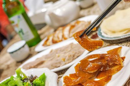 china cuisine: Eating roast duck at a Beijing roast duck restaurant