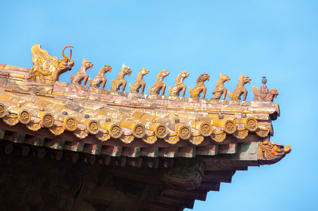 Ornate roof figurines at the Forbidden City Beijing China