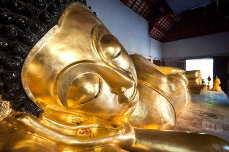 reclining: Reclining Buddha at Wat Phra Singh, Chiang Mai, Thailand Stock Photo