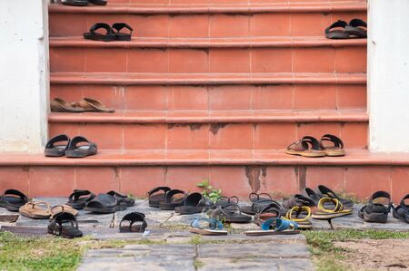 Shoes left on temple steps, Thailand Stock Photo