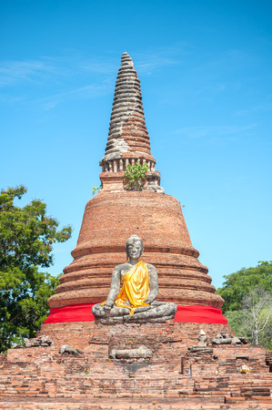 seated: Seated Buddha statue at Wat Worachet Tharam, Ayutthaya, Thailand Stock Photo
