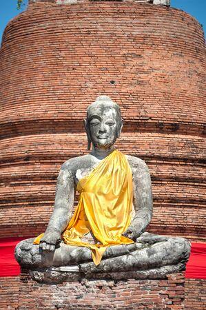 sash: Broken Buddha with yellow sash at Wat Worachet Tharam, Ayutthaya, Thailand