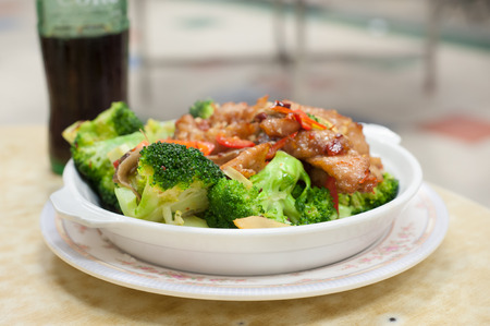 Stir-fried pork and broccoli dish served at a Hong Kong Cooked Food Centre