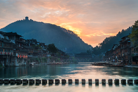stepping stone: Sunrise on the Tuojiang River, Fenghuang, Hunan Province, China Editorial