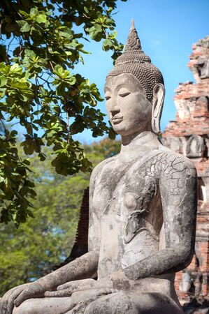 stone buddha: Stone Buddha statue seated in the lotus position at Wat Mahathat, Ayutthaya, Thailand