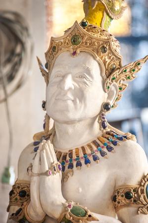 chan: Statue of the actor Jackie Chan at Wat Pariwat, Bangkok
