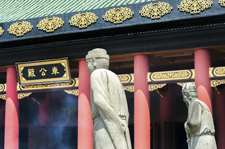 Statues outside the main hall at Che Kung Temple, Sha Tin, Hong Kong. The name on the building reads , meaning Che Kung Hall.