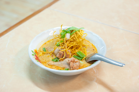 soi: A bowl of tasty khao soi gai chicken noodles served at a Ching Mai restaurant on June 8, 2015. Khao soi is one of Chiang Mais most famous dishes