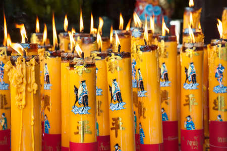 alight: Burning candles at a Chinese temple Stock Photo