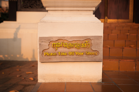 Please Take Off Your Shoes sign at Wat Chedi Luang, Chiang Mai, Thailand