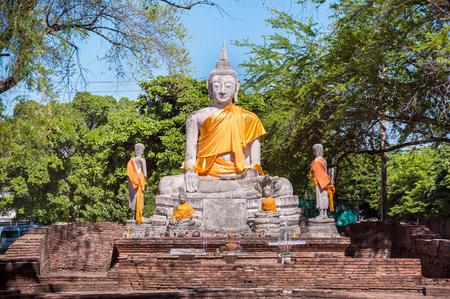 sash: Large stone Buddha statue with orange sash, Ayutthaya, Thailand