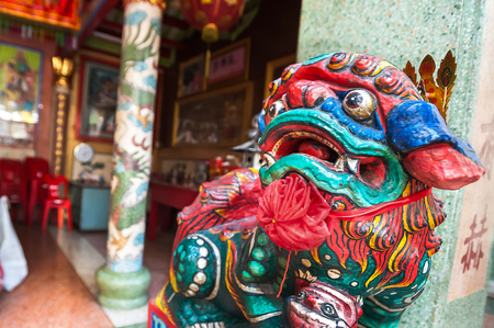 Colourful lion guardian at the entrance to a Chinese temple in Bangkok, Thailand