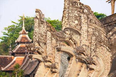 Naga serpent sculptures surrounding the main chedi at Wat Chedi Luang in Chiang Mai, Thailand