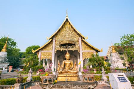 Buddha statue outside the main wiharn at Wat Chedi Luang, Chiang Mai, Thailand
