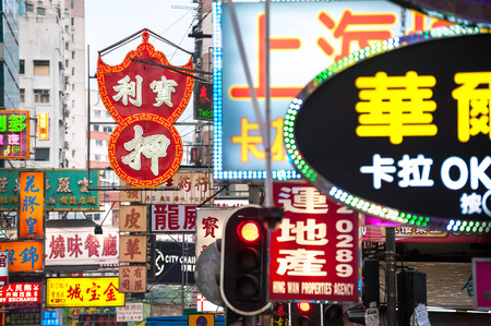 street signs: Neon signs on a Kowloon street, Hong Kong Editorial