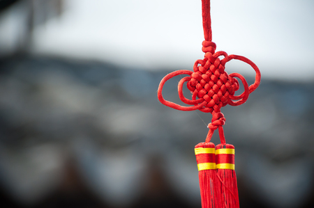 knotting: A red Chinese knot decoration hanging in a Suzhou street Stock Photo