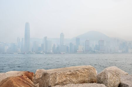 air view: The skyscrapers of Hong Kongs financial district and Victoria Peak obscured by air pollution Stock Photo