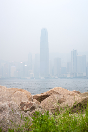 obscured: IFC skyscraper in Hong Kongs Central district obscured by air pollution Stock Photo