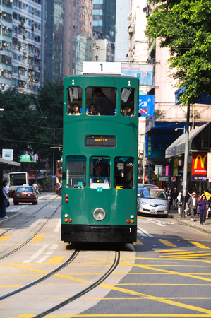 Traditional Hong Kong tram makes its way along Johnston Road in the Wan Chai district of Hong Kong Island Publikacyjne