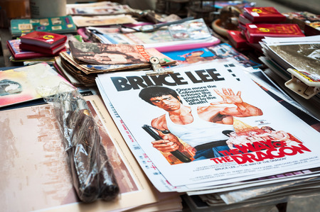 SHEUNG WAN, HONG KONG - OCT 2, 2013 - Bruce Lee posters on sale at Upper Lascar Row street market, Sheung Wan, Hong Kong Editorial
