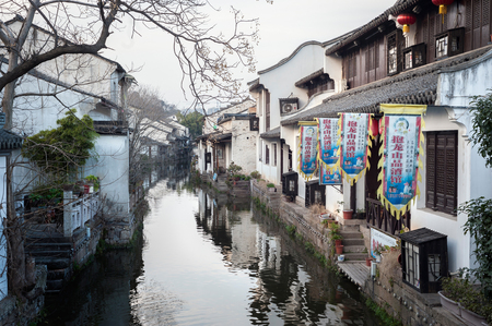 Traditional whitewashed buildings line a canal in the eastern Chinese city of Shaoxing.