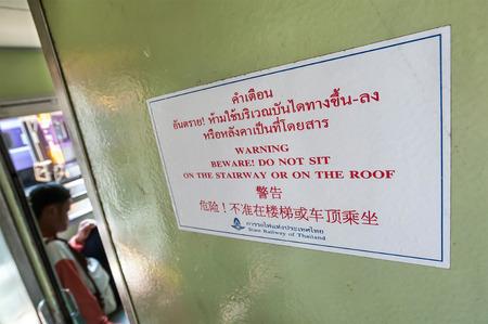 Warning sign onboard a Thai train