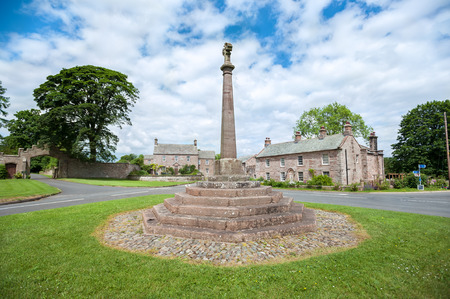 Stone cross in the village of Greystoke, Cumbria Stock fotó - 92680836