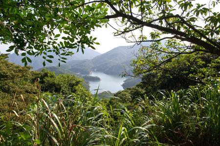 香港島のタイタムカントリーパークに位置し、タイタム貯水池周辺のエリアは、人気の香港ハイキングスポットです。 写真素材