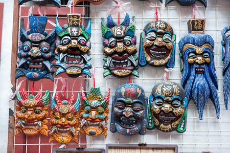 Wooden Chinese masks on sale at a souvenir market near Yu Garden, Shanghai