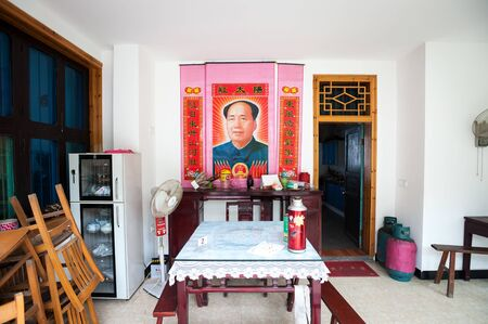 Chairman Mao poster inside a Chinese dining room