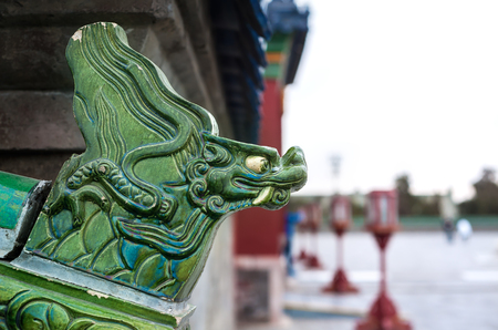Green ceramic dragon head on an exterior wall at the Temple of Heaven, Beijing