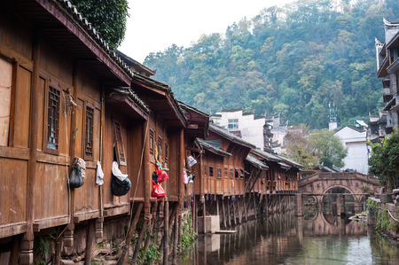 FTraditional wooden buildings and ancient stone bridge in Fenghuang Ancient Town, Hunan Province, China