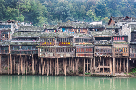 FENGHUNG, CHINA - NOV 12, 2014 - Traditional stilt houses on the Tuojiang River, Fenghuang, China Editorial