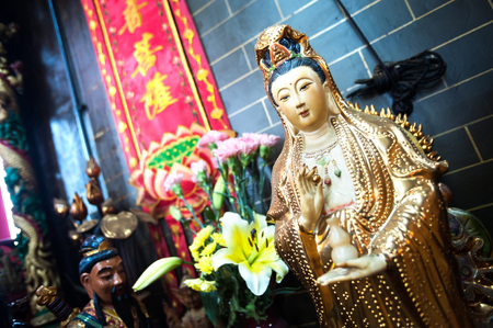 Statue of Guanyin, the Goddess of Mercy, at a Hong Kong temple Stock Photo