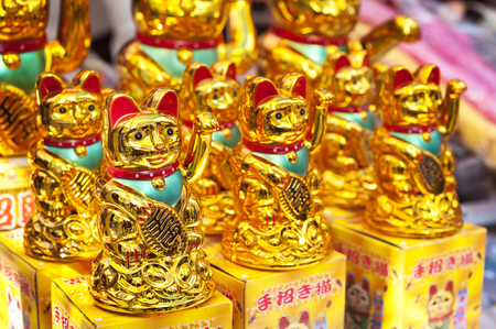 Lucky fortune cats at a Hong Kong market stall