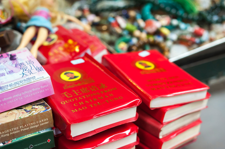 Chairman Maos Little Red Book on sale at Upper Lascar Row street market, Sheung Wan, Hong Kong