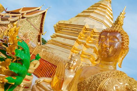 Golden chedi and Buddha statues at Wat Phra That Doi Suthep, Chiang Mai Stock Photo