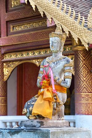 Praying Buddha statue outside Wat Chiang Man, Chiang Mai