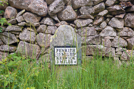 Old-style milestone on the Coast to Coast cycle route, Cumbria, UK