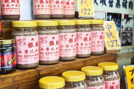 TAI O, HONG KONG - SEPT 8, 2013 - Jars of shrimp paste on sale in Tai O village, Lantau Island, Hong Kong Editorial