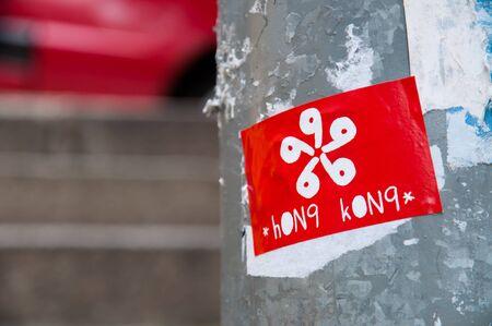 Sticker of a Hong Kong flag attached to a lamppost in Sheung Wan, Hong Kong Stock Photo