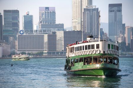 VICTORIA HARBOUR, HONG KONG - SEPT 9, 2013 - Hong Kongs Star Ferry crossing Victoria Harbour.